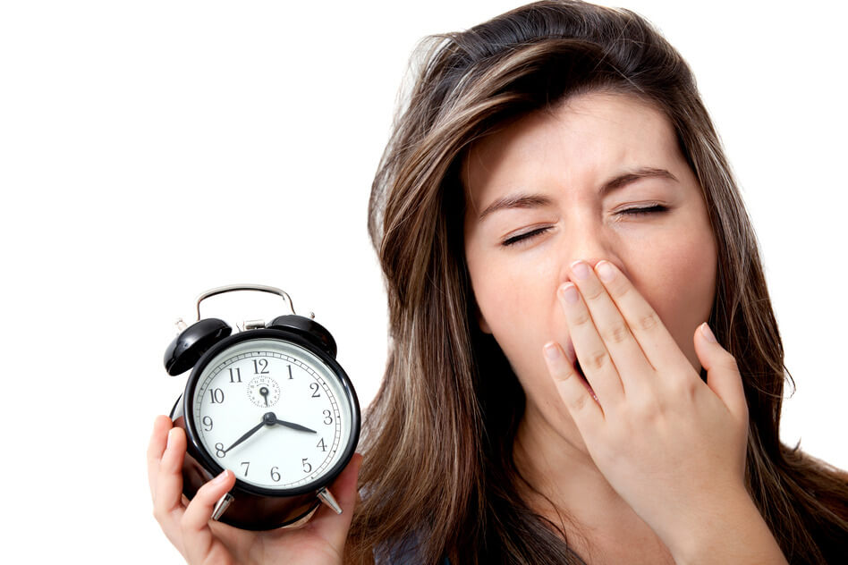 Tired woman suffering from insomnia and yawning - isolated